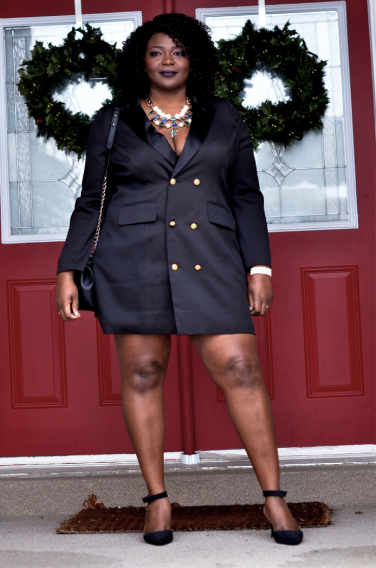 33ed90e2cf Look confident in this stylish black tuxedo dress with gold buttons that  flatters your plus size body.